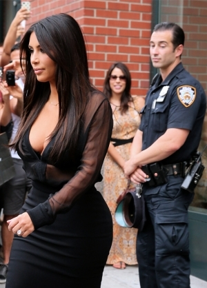 Caught On Cam!: Police Officer Caught Checking Out Kim Kardashian's Butt